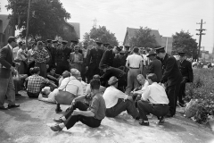 Strikers sat and lay down on the road to prevent traffic from entering the city's east end dump. Some were arrested for obstructing the police, 1950. Courtesy of The Hamilton Spectator Collection, Local History & Archives Department, Hamilton Public Library.