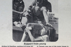 A child enthusiastically covers a Local 167 member with strike-support stickers, November 1973. Courtesy of CUPE Journal.