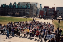 Delegates from CUPE National Health and Safety Conference in Ottawa attend a rally was at Parliament Buildings in support of the Day Of Mourning. The people in front with flowers represent all the provinces and territories, ca. 1988. Courtesy of Ed Thomas.