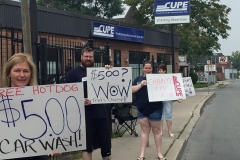 Members at car wash fundraiser at the 818 King Street East office, ca. 2014. Courtesy of CUPE Local 5167.