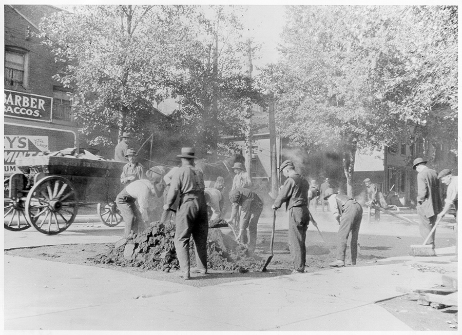 1911 - Outside workers laying sidewalk foundations