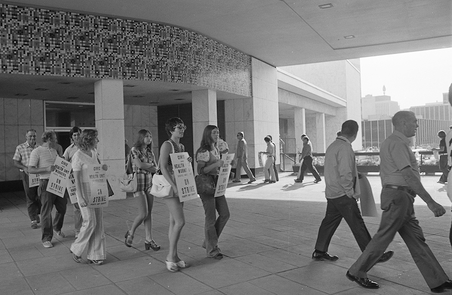Striking workers picket outside city hall, 1973